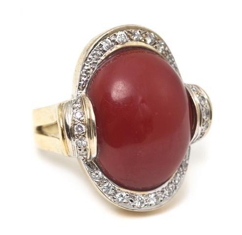 20: An 18 Karat Yellow Gold, Coral and Diamond Ring, 9.