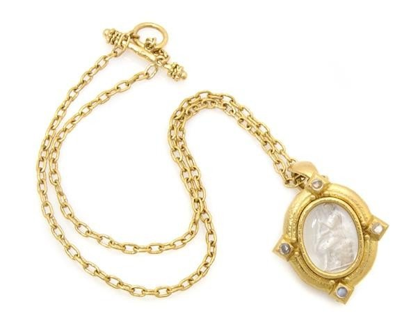 252: An 18 Karat Yellow Gold, Moonstone and Carved Rock
