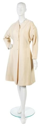 151: An Adolfo Cream Wool Coat.