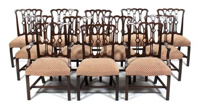 16: A Set of Twelve Chippendale Mahogany Dining Chairs,