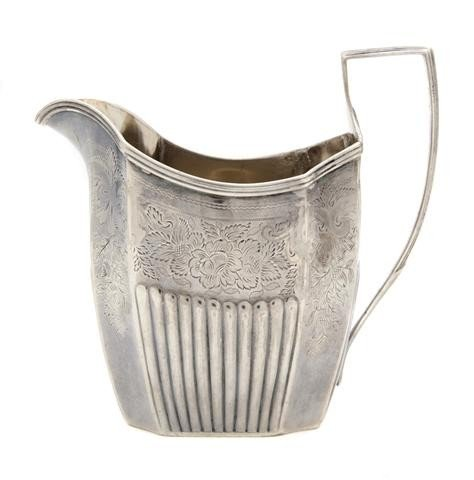 644: An English Silver Creamer, Height 4 3/4 inches.