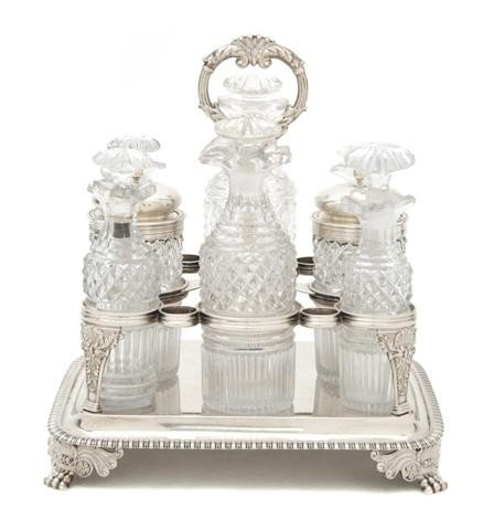 649: An English Silver and Cut Glass Caster Set, Height