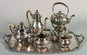 383: A Six Piece Silver Plate Tea and Coffee Service, H