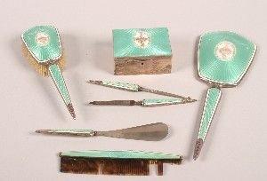 403: A Seven Piece Enamel and Silver Dresser Set. Lengt