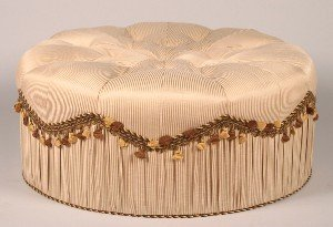 682: A Circular Upholstered Ottoman.
