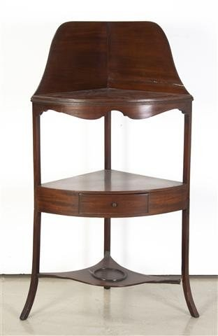 12: An English Mahogany Corner Washstand, Height 43 1/2