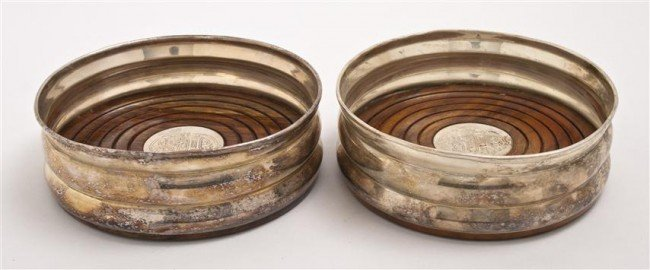 500: A Pair of Mahogany and Silverplate Wine Coasters,