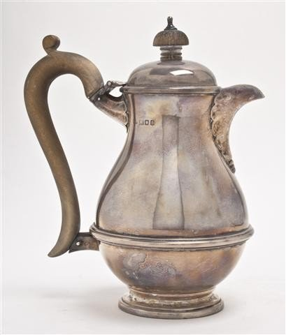 504: An English Silver Milk Pitcher, Height 7 inches.