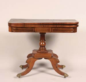 7: A Regency Brass Inlaid Walnut Games Table,