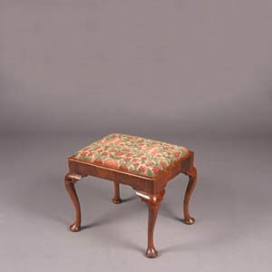 17: A Queen Anne Walnut Footstool,
