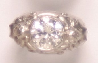 717: A Platinum and Diamond Ring,