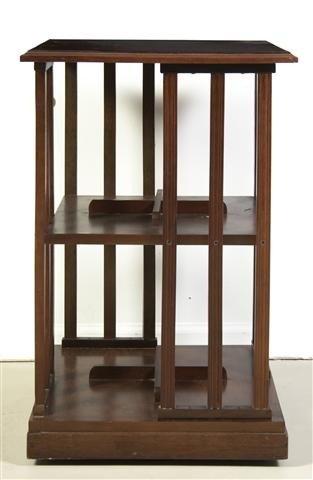 13: A Mahogany Rotating Bookshelf, Height 27 3/4 x widt