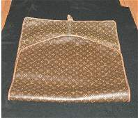 353: Two Louis Vuitton Folding Garment Bags