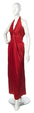 20: A Travilla Red Pleated Evening Gown,