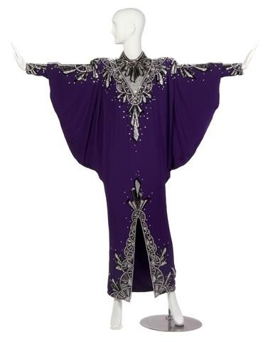 22: A Tony Chase Custom Purple Silk Evening Gown,