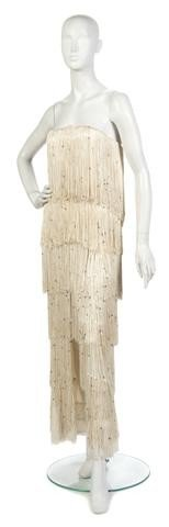 23: A Richilene Cream Fringe and Sequin Evening Gown,