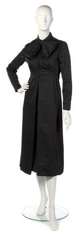 74: A Teal Traina Black Silk Dress.