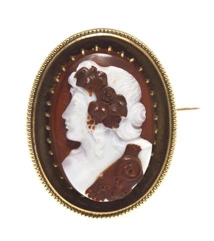 13: A Victorian Yellow Gold and Sardonyx Cameo Brooch,