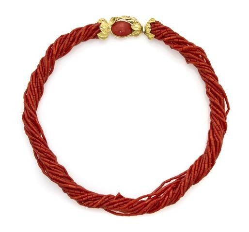 17: An 18 Karat Yellow Gold and Multi Strand Coral Bead