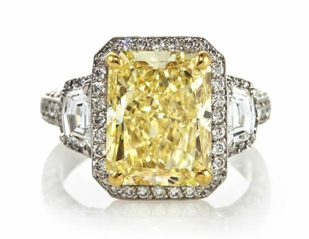 305: A Platinum and Fancy Yellow Diamond Ring, Michael