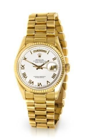308: An 18 Karat Yellow Gold President Wristwatch, Role