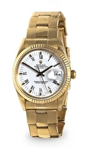 311: A 14 Karat Yellow Gold Oyster Perpetual Wristwatch