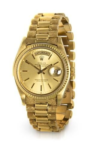 312: An 18 Karat Yellow Gold President Wristwatch, Role