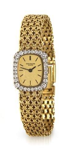 322: An 18 Karat Yellow Gold and Diamond Wristwatch, Pa