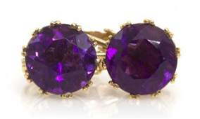 569 A Pair of 14 Karat Yellow Gold and Amethyst Earcli