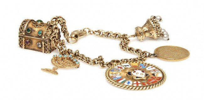 574: A 14 Karat Yellow Gold Charm Bracelet with Five At