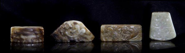 5: A Group of Four Archaistic Jade and Hardstone Fittin