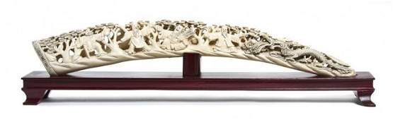250: A Chinese Carved Ivory Tusk, Length 21 inches.