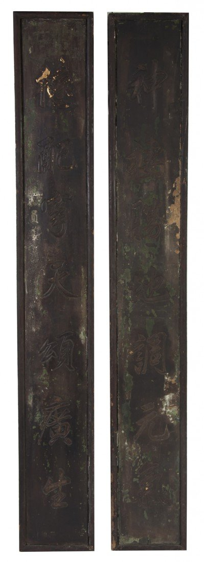 478: A Pair of Chinese Door Markers, Height 58 inches.