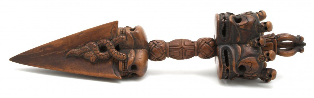 492: A Southeast Asian Carved Wood Vajra, Length 15 inc