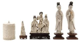 624 A Collection of Four Carved Ivory Figural Articles