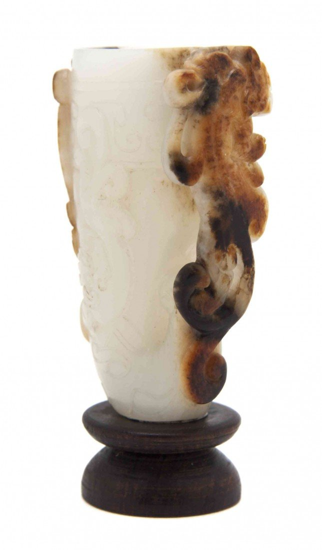 527: A White Jade Rhyton, Height 2 3/8 inches.