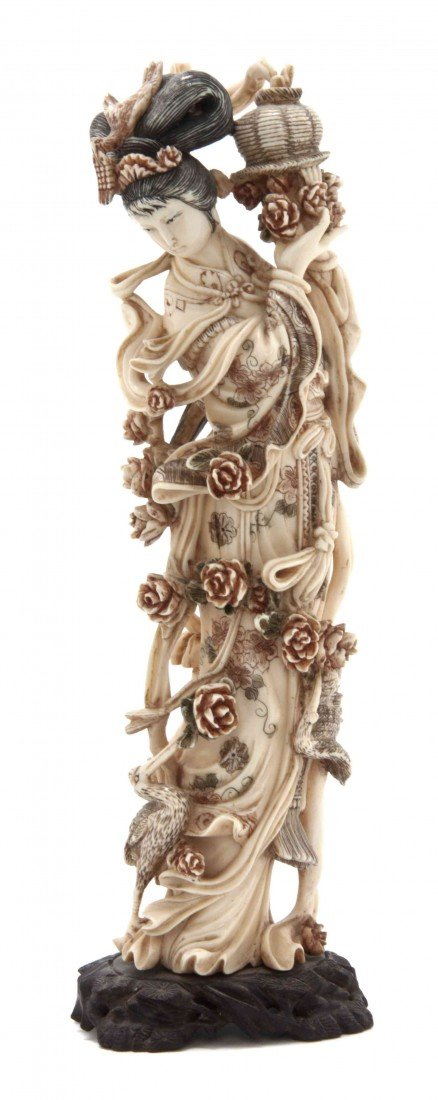 650: A Chinese Carved Ivory Figure, Height 10 1/2 inche