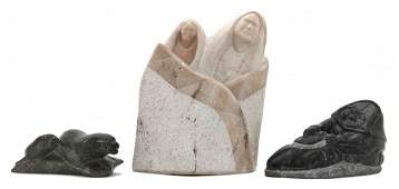 926: A Group of Three Carved Inuit Figures, Length of l