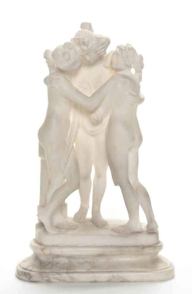15: An Alabaster Figural Group, Height 9 1/4 inches.