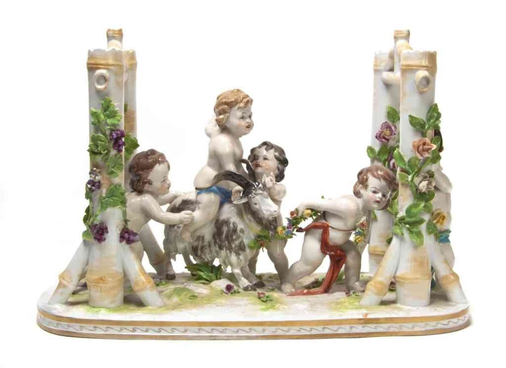 18: A Capodimonte Figural Group, Width 16 inches.