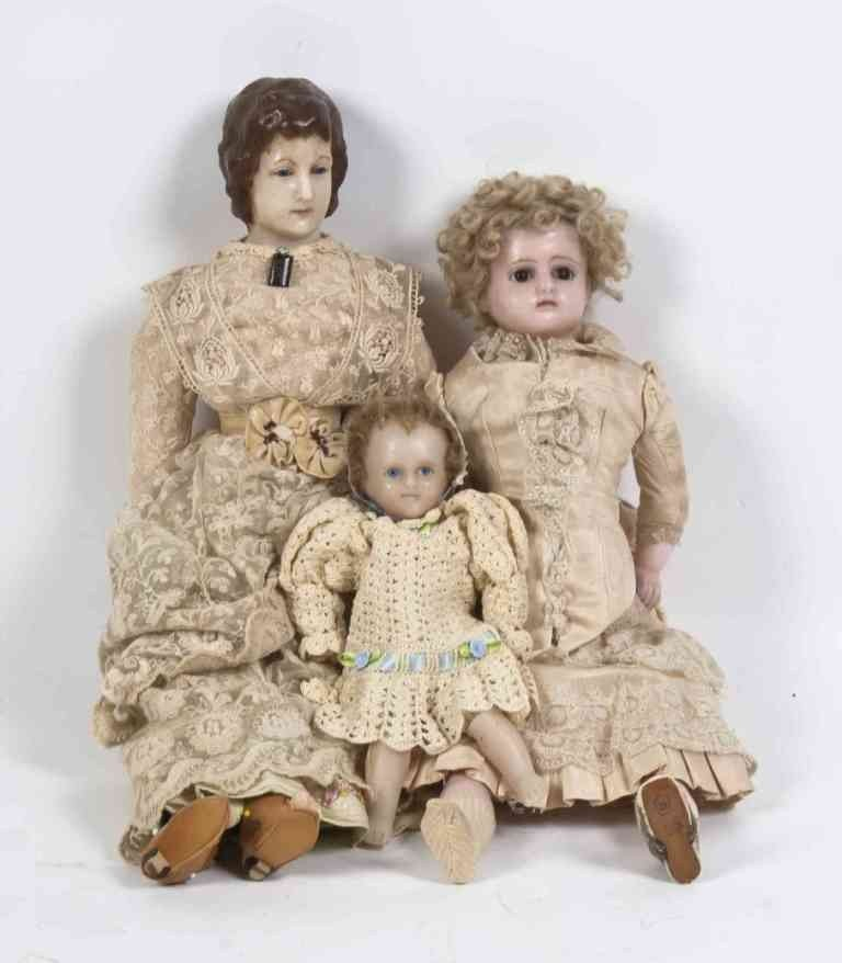 48: A Collection of Three Wax Head Dolls, Height of tal