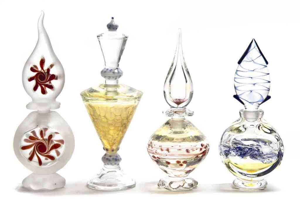 A Group of Four Contemporary Glass Perfume Bottles