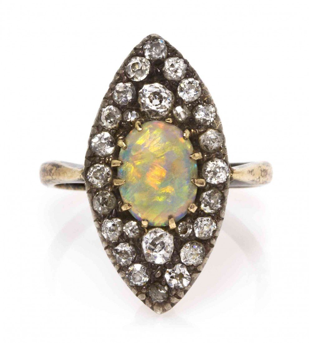 10: A Victorian Silver Topped Gold, Opal and Diamond Ri