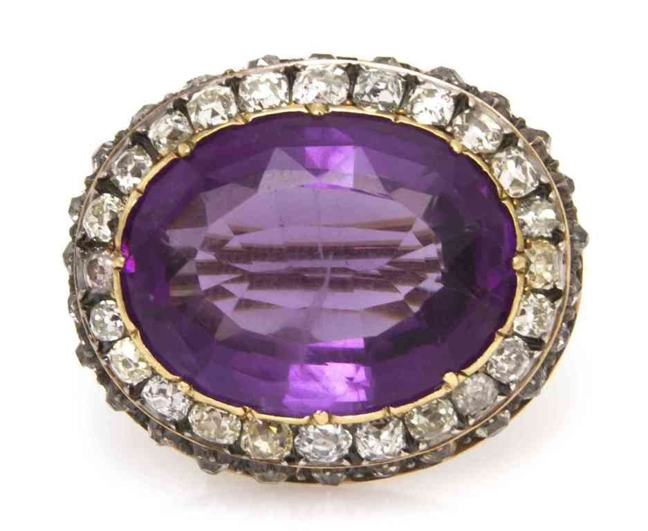 23: A Victorian Silver Topped Gold, Amethyst and Diamon