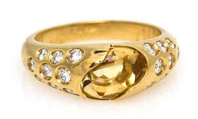280 An 18 Karat Yellow Gold Citrine and Diamond Ring