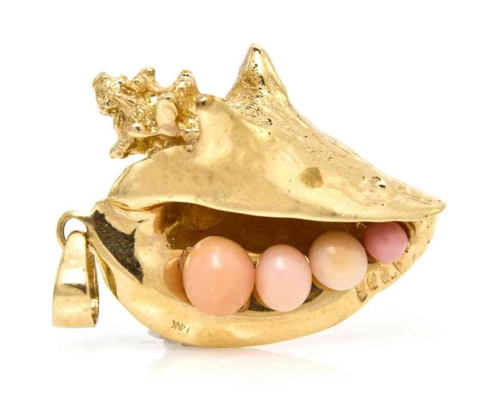 406: A 14 Karat Yellow Gold and Natural Conch Pearl Pen
