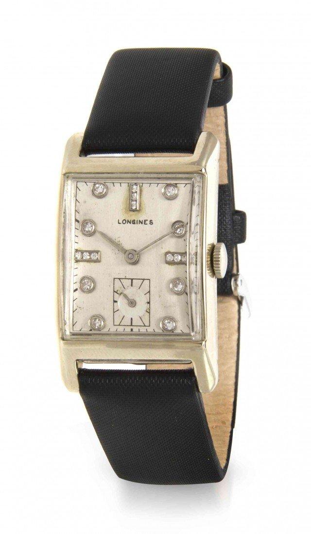 437: A 14 Karat White Gold and Diamond Wristwatch, Long