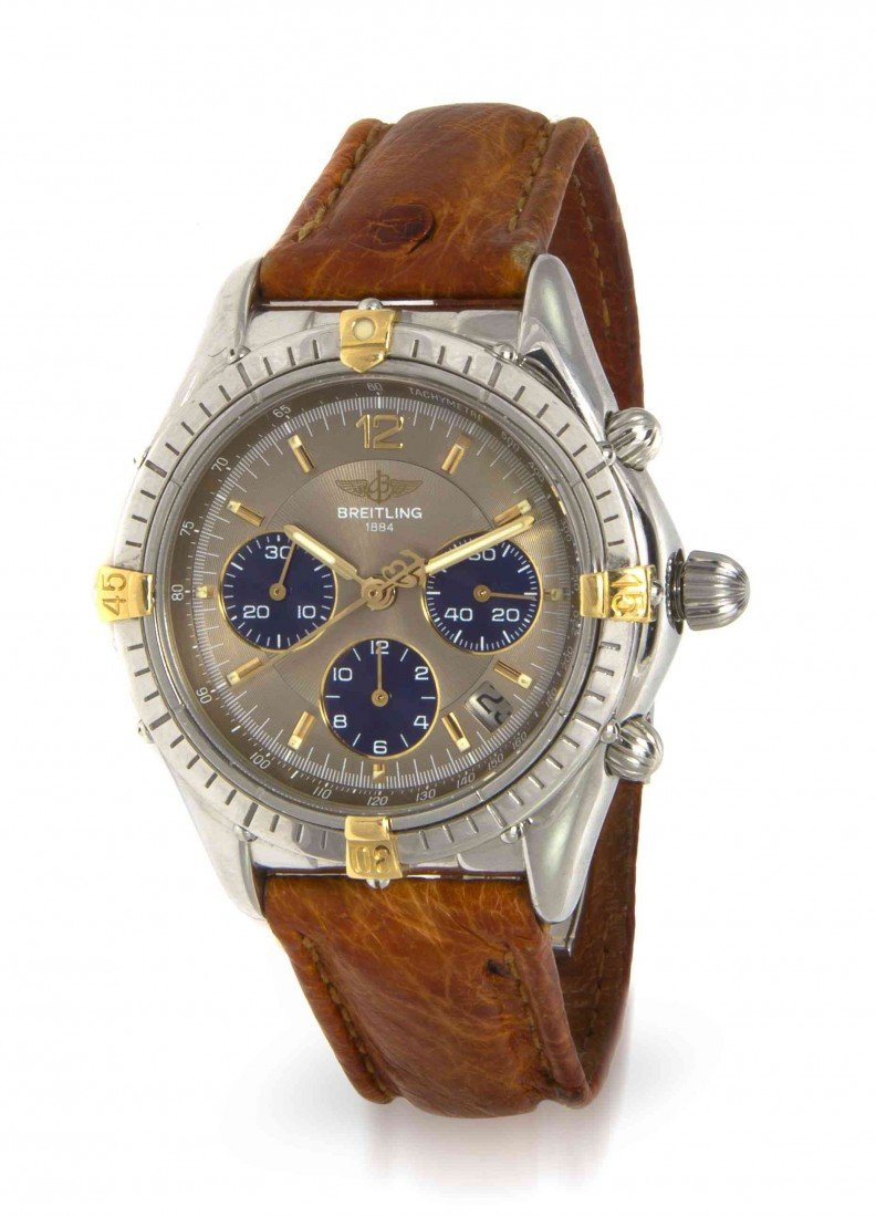 442: An 18 Karat Yellow Gold and Stainless Steel Chrono