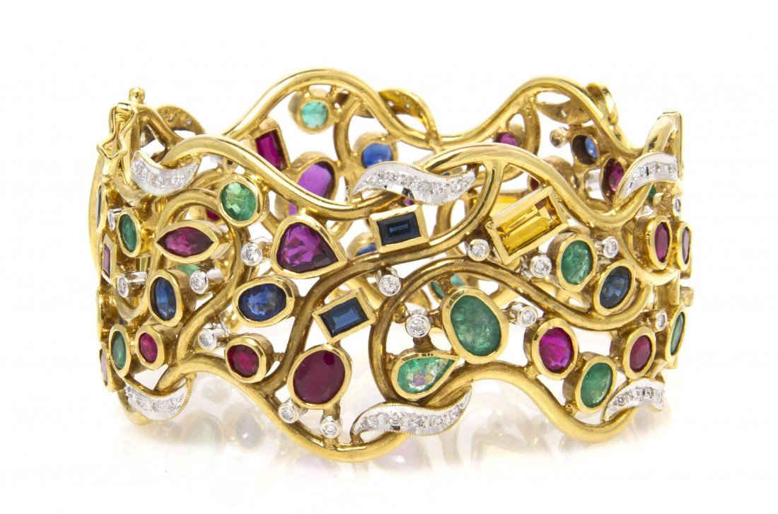 527: An 18 Karat Yellow Gold, Ruby, Sapphire, Emerald,