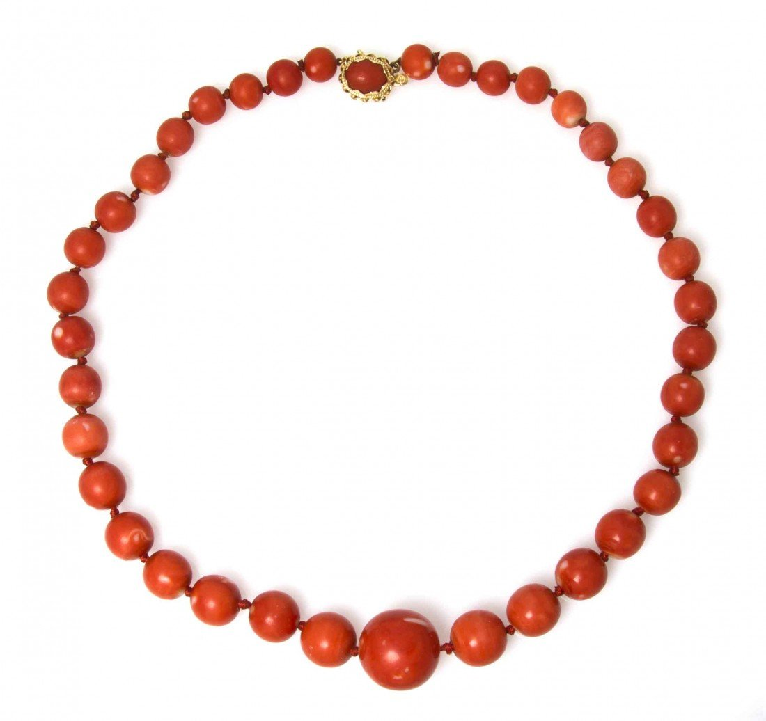 545: A Graduated Single Strand Coral Bead Necklace,